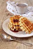Belgian Waffles With Syrup And A Cup Of Cocoa
