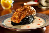 Crisp Salmon Steak with Black Risotto and Cream Sauce