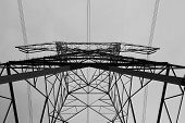 picture of electricity pylon  - Black and white below view of an electricity pylon - JPG