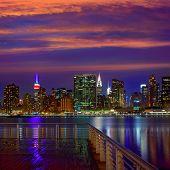 Manhattan New York skyline at sunset rainy dusk from East River NYC USA