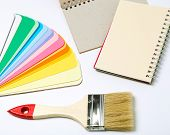 Rainbow paper with brush and notepad