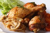 Baked Chicken Drumsticks With Mushrooms. Horizontal Close-up