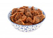 Chopped Dried Figs In A Blue And White China Bowl