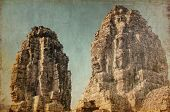 Faces of ancient Bayon Temple At Angkor Wat in retro and grunge style. Siem Reap, Cambodia