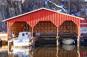 Red Wooden Garage For Three Boats