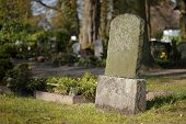 stock photo of tombstone  - Tombstone on a graveyed near Greifswald Mecklenburg - JPG