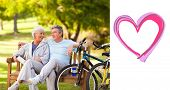 Elderly couple with their bikes against heart
