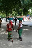 Two Black Women Carry Goods On Their Heads