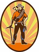 Miner prospector or gold digger with pick axe and shovel