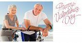 Retired couple with their bikes on the beach against cute valentines message