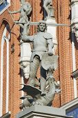 Statue of the knight defeating a dragon in front of the House of Blackheads in Riga, Latvia.