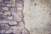 Old rough grey stone wall texture
