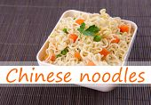 picture of chinese parsley  - Chinese noodles with vegetables in bowl on bamboo mat background and space for your text - JPG