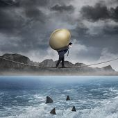 Businessman Carry Golden Egg Above The Sea