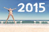 Carefree Girl At Beach With Numbers 2015