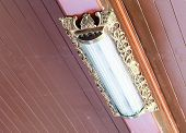 pic of fluorescent  - White fluorescent bulb in the traditional Thai carving case - JPG