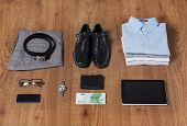 business, style, clothes and objects concept - close up of formal male clothes and personal stuff on wooden table at home