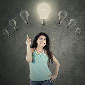 Indian Woman Under Lightbulb