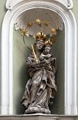 GRAZ, AUSTRIA - JANUARY 10, 2015: Virgin Mary with baby Jesus, statue on the house facade in Graz, Styria, Austria on January 10, 2015.