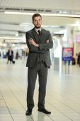 Young Businessman at the airport with his arms crossed