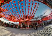 KUALA LUMPUR, MALAYSIA - FEBRUARY 08, 2015: Tourists visit the scenic Thean Hou Temple with hundreds of lanterns hung across the courtyard. This is in preparation for the coming Chinese New Year.