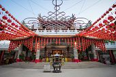 KUALA LUMPUR, MALAYSIA - FEBRUARY 08, 2015: Tourists visit the scenic Thean Hou Temple with up hundreds of lanterns hung across the courtyard. This is in preparation for the coming Chinese New Year.