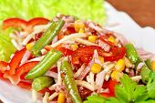 Salad from ham, tomato, green beans, corn and greens