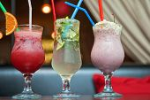 Set of three healthy nonalcoholic cocktails berries and classic mohito