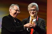 BERLIN, GERMANY - FEBRUARY 12: Dieter Kosslick presents the Honorary Golden Bear to Wim Wenders.  65th Berlin International Film Festival at Berlinale Palace on February 12, 2015 in Berlin, Germany.