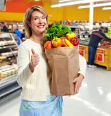Senior shopping woman with grocery items. Healthy diet.