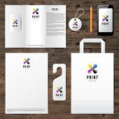 Identity template with cmyk logo design over wooden background