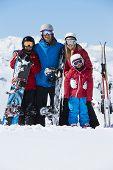 stock photo of family ski vacation  - Family On Ski Holiday In Mountains - JPG
