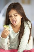 stock photo of fussy  - Unhappy Young Girl Rejecting Plate Of Fresh Vegetables - JPG
