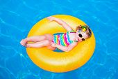 stock photo of rings  - Child in swimming pool - JPG