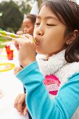 picture of blowers  - Girl With Blower At Outdoor Birthday Party - JPG