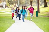 pic of 11 year old  - Group Of Children Running Along Path Towards Camera In Park - JPG