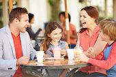 picture of 13 year old  - Family Enjoying Snack In Caf - JPG