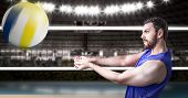 picture of volleyball  - Volleyball player on blue uniform in volleyball court - JPG