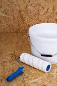 image of lint  - set for painting bucket of white paint roller - JPG