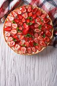 pic of tarts  - homemade tart with fresh strawberries mint and cream cheese on a table - JPG