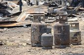 stock photo of petroleum  - Burnt liquid petroleum gas cylinder in fire situation - JPG