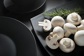 image of champignons  - Fresh mushrooms champignons on a black background close up - JPG