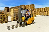 foto of forklift  - Forklift operator in pallet warehouse on the open - JPG