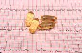 image of electrocardiogram  - Electrocardiogram graph and pills ekg heart rhythm medicine concept - JPG