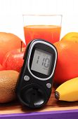 image of immune  - Glucose meter fresh ripe natural fruits and glass of juice on cutting board concept for diabetes healthy nutrition and strengthening immunity - JPG