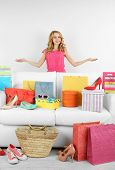 stock photo of shoe-box  - Woman with shopping bags and shoes on sofa in room - JPG