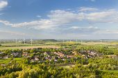 picture of west village  - Flat west German landscape near Aachen and Herzogenrath with lots of wind turbines and a village in the foreground - JPG