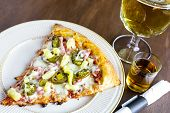 image of draft  - Pineapple ham and hot peppers pizza with draft beer and a premium well shot - JPG