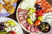 stock photo of antipasto  - Appetizers plate with vegetarian antipasto in Italian restaurant - JPG