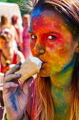 pic of holi  - multicolored girl eating ice-cream at Holi Festival ** Note: Visible grain at 100%, best at smaller sizes - JPG